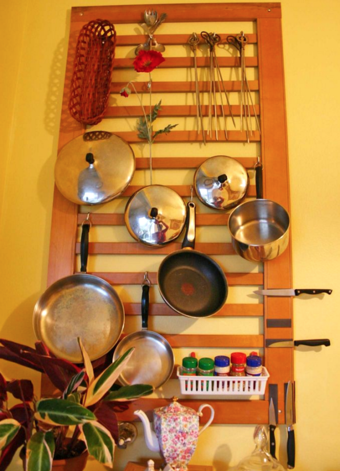 An Old Crib in the Kitchen as a Perfect Storage Option for Pots and Pans